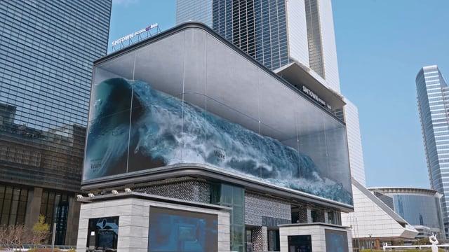 Wellen an einer Häuserwand
